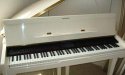 This beautiful digital baby grand piano is in like~new condition ! It is also a player piano that can record your performances !! Features allow you to play piano, create complex arrangements with hundreds of instruments recording tracks to create