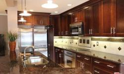 This is a must see property located in the heart of Westlake Village! The kitchen is a chef's dream! It features granite counters, ceramic cook top, stainless steel appliances, and more. Offers high end upgrades throughout including travertine floors,