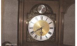 Beautiful Grandmother Clock mfg by Colonial Mfg. Co. Finished in walnut. The chimes need adjustment but all parts are present.