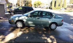 2005 Ford Focus w/111,560 miles 4 door Mint Green/tan interior sedan 4 New tires w/warranty and Spare new Transmission needs a little work $1500.00 -or Best Offer Call (916) 548-0863