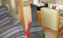 squier red acousticguitar with fender soft case