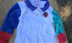 Cute Gymboree boys shirt in great condition. This is marked size Infant. Shirt is white with one blue and one green sleeve.