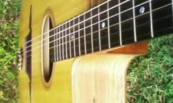 An Ivanovski d-hole gypsy guitar - spruce top - walnut back and sides - ebony fretboard - - 10 years old - from Yugoslavia - - never really played too much at all.... with a hrd shell case - -  ALSO a Christophe Lesgourgous