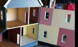 """Large Doll House. Needs some loving care. Hate to sell. Made for my daughters .misc. furniture included. 34""""x28""""x42"""""""" tall."""