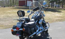 2005 FLSTC Black Heritage Softail Classic in mint condition. Lots of extra crome parts and a one time owner. 16600. miles and recondition bags. Helmets, leather jacket, boots, clothing etc., also for sale as well. Have to see to really
