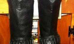 I have a great pair of Harley Davidson boots, womens size 8. These where purchased for a friend to use in some local photo shoots. They were worn only for photo shoots. In GREAT Shape. Older style but Harley never goes out of style!! :) Retailed for