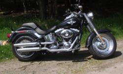 Harley Davidson Fat Bob 2014  2500 miles Comes with a 5 year extended warranty like none other. For example if you break down in California and it can't be fixed until the next day they will pay for room and food. They will even come to your