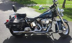 Second owner of this beautiful 2001 Heritage that has been updated to the big bore engine by original owner, with Vance & Hines two into one pipes.. It is over 117 HP, has compression buttons to start, and a very smooth ride. Per doctors orders, no