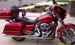 2010 harley flhx custom,chrome everything,stage 2 kit,custom rear fender and chin spoiler,chrome adjustable heli bars,corbin heated seat and driver backrest,abs brakes,heated grips,harman kardon radio with cd,$1,000 j and m speakers,bub 2into1
