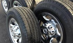 This Came off a Dodge Truck 8 lug Rim with Caps and Lug Nuts The Michelin Tires they have about 75% Tread on them LT 265/70R17 LTX A/S Im asking $600.00 i like to stay in that range but i will take offers....... Give me a call if you would