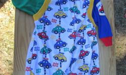 Adorable Healthtex boys creeper with cars sprinkled all over it. This is in fantastic condition and is a size 6-9 months.