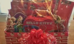 Hello Kitty Activity Basket!!! Basket Contains: Coloring Book, Crayons, Paint Book, Travel Kit, Pencils, Pen, Metal Lunch Box, Metal Playing Cards Tin containing 4 card games, Playing Cards, Jump Rope, Magnetic Writing Tablet, Spiral Writing Tablet, Jelly