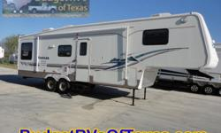 Long weekends at the lake are right around the corner! Relax at the lake in total comfort and style with this exciting 34ft 5th wheel trailer for sale! With plenty of room for the family thanks to the super slide everyone will enjoy creating memories that