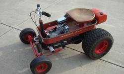 Hot Rod Radio Flyer wagon.  6 1/2 HP Honda clone engine with spring front suspension and full differential rear end which makes for easy handling.  Top speed is approximately 25 MPH.  Wagon was built about 8 years ago and has been to a