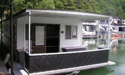 HOUSEBOAT FOR SALE 38' X 16' South Holston Lake 2 bedrooms, 1 with queen size bed, 1 with 4 bunk beds Kitchen Bath, Shower, Separate sink Gas stove Refrigerator gas/electric Water heater Furnace On-demand water pump Inside steering Depth finder Inverter