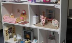 This listing is for a beautiful 7 room custom made and furnished dollhouse for Barbie. It is furnished with great love and detail....from the oriental rugs, diapers, wipes, toys in the nursery to the Scott tissue, Crest toothpaste, Ivory Soap,