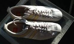 Size: Euro 43, US men 10, women 12, in new condition