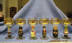 Add that touch with beautiful wine glasses imported from Germany. Grape leaves and vines are carefully engraved into the glass with a diamond wheel and than accented in 14K gold rim. Each figurine is individually hand-painted. Included in each set is a