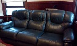 Lazy Boy Leather couch that reclines on both sides. Excellent condition. Call --