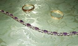 14ct gold engagement ring 1/4ct diamond center with 6 diamonds down each side, size 10, 10ct gold thumb ring, size 11, silver decorative Amethyst bracelet.