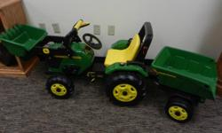 This newJohn Deer Riding Peddel Tractor is chain driven and features a front loader and tws a trailer