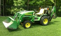 John Deere 4110 Utility Tractor ? 2005 Diesel, HST, 4 WD with turf tires, 21 hp, 114 hours with Backhoe and bucket. Garaged every year, one owner. Delivery not included.