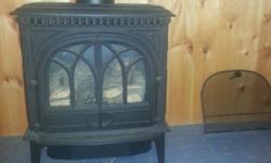 Jotul 3 cast iron propane gas stove, pipe included.