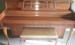 40 yr old piano with bench included