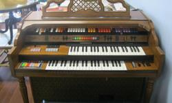 Kimball Paradise Electric Organ with matching Leather Topped Seat - $300.00. Excellent Condition! Can be seen at: J&Ls Resale Oasis 12665 Seminole Blvd. Largo, FL Or Call: 727-953-9853 Or Email: jandlsresaleoasis at yahoo