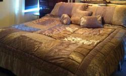 Make an offer , will ignore ridiculously low offers - I paid a pretty penny for it. Set includes: 1 comforter 2 pillow shams 3 decorative pillows Bed skirt + Matching gold curtains Email or text 561-688-3510