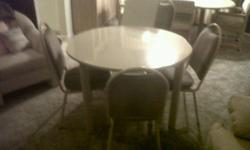 "4 chairs upholstered in light brown cloth. table top has a insert to expand by 18"". good condition with no tears or scratches"