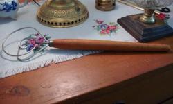 Kitchen Utensil, vintage, Wooden handle, Rest metal, good condition.