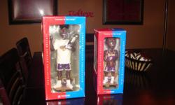 Kobe with lakers uniform and basketball in hands Shaq with trophy and championship shirt.They are both in theire original boxes never been opened.