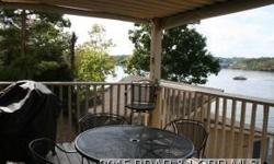 Lake Ozarks condo at Parkside Place in Building A. Lower level condo gives you access to walk right off of your deck to the boat docks. Nicely furnished, great neutral decor, lakefront master suite, and a beautiful view of the Grand Glaize Arm and