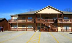 Branson Condo with Lake View and Lake Access of the beautiful Table Rock Lake. Step inside this fully-furnished condo for lake-side living at its finest. Enjoy the raised ceilings, tile floors, granite counters and up-to-date paint pallet and fixtures.