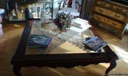 excellent condition Large coffee table dark brown wood with glass