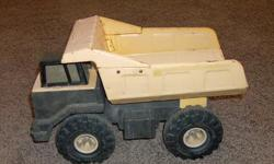 """This is a Tonka truck in good shape. 17"""" long by 10"""" high"""