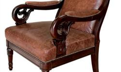 Perfect condition leather and wood arm chair; stately looking; scroll work on legs and arms; arms have leather trim with nail heads; leather on back of chair, as well.