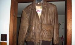 Ladies Medium Leather Bomber Jacket. Worn a few times. Good Condition.