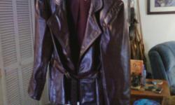 Leather belted jacket like new. Womens size medium.