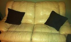 Love seat is a cream color leather and reclines. Matching reclining couch. Couch has tear in middle seat. So listed price is 250.00