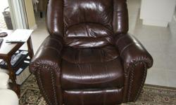 Brown leather reclining chair that rocks and swivels, like new condition, purchased for $799. +tx Also for sale: Matching leather console sofa with 2 rocking and reclining chairs paid $1000. would sell for $500.
