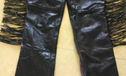 Black leather riding chaps, size small. Like new.