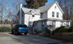 Legal Two Family: 3Bdrms 2 full bths 1st fl, 2 Bdrm 1 full bth 2nd floor part utilitity basement Detach 2 car garage