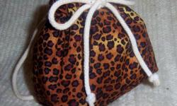 Handmade backpack made for American Girl Dolls but will fit 16 and 18 inch dolls.   Material is a black and brown leopard print cotton outside and black cotton inside. It measures about 4 by 4 inches.  A unique addition for any doll