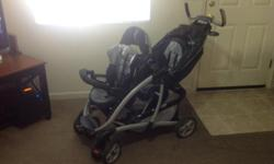 Double stroller is in excellent condition , Black and silver in color, has basket for storage,cup holders, compartment on handlebars, deluxe in every sense of the word. A must see!!