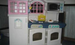 """little tikes """"victorian kitchen"""" in excellent condition, 45""""L X 40""""H X 14""""D. Kitchen unit as shown includes side by side oven, range, microwave, window, sink, wall phone, refrigerator w/water dispenser, and cupboard. Shown in the sink and on the counter"""