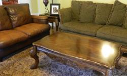 BERNHARDT Dark Green Couch, Dark Brown Leather Chair, Loveseat and Recliner... Coffee Table and 2 End Tables that match the wood trim on the Couch.