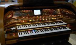 Item: Organ Price: $3,900 Location: Main House Airconditioned Year: 2001 Make: Lowery Model: SU-400 Rhapsody Color: Shiny Dark Brown Wood http://www.lowreyforum.com/brochures/SU400_Rhapsody.pdf Description: Perfect condition. Kept in AC home.