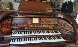 Top of the line Lowrey organ. Model# SU500, Serial# U500 104 F1 26645. One owner and in excellent condition. Features include: touch screen, disk,mircophone and headphone plugs. Matching bench with side compartments that